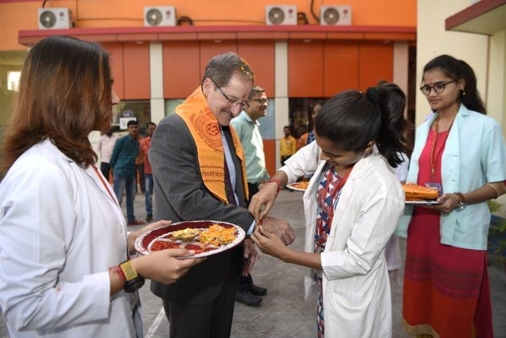 Orbis CEO Bob Ranck receiving a warm welcome to India with a traditional plate of food