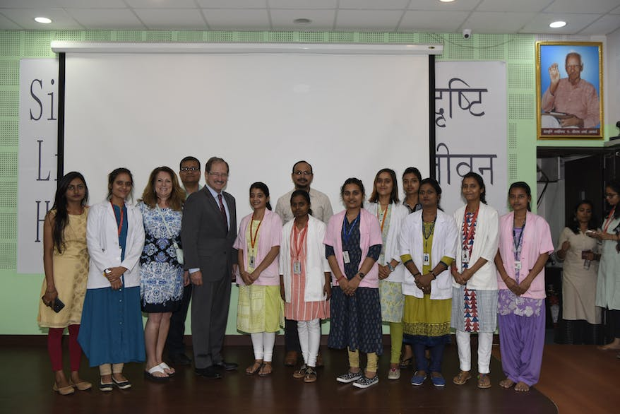 CEO Bob Ranck with the women employed at the new Children's Eye Center