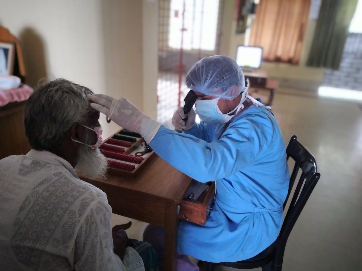A man is screened by the REACH team at VMANNN Hospital, India