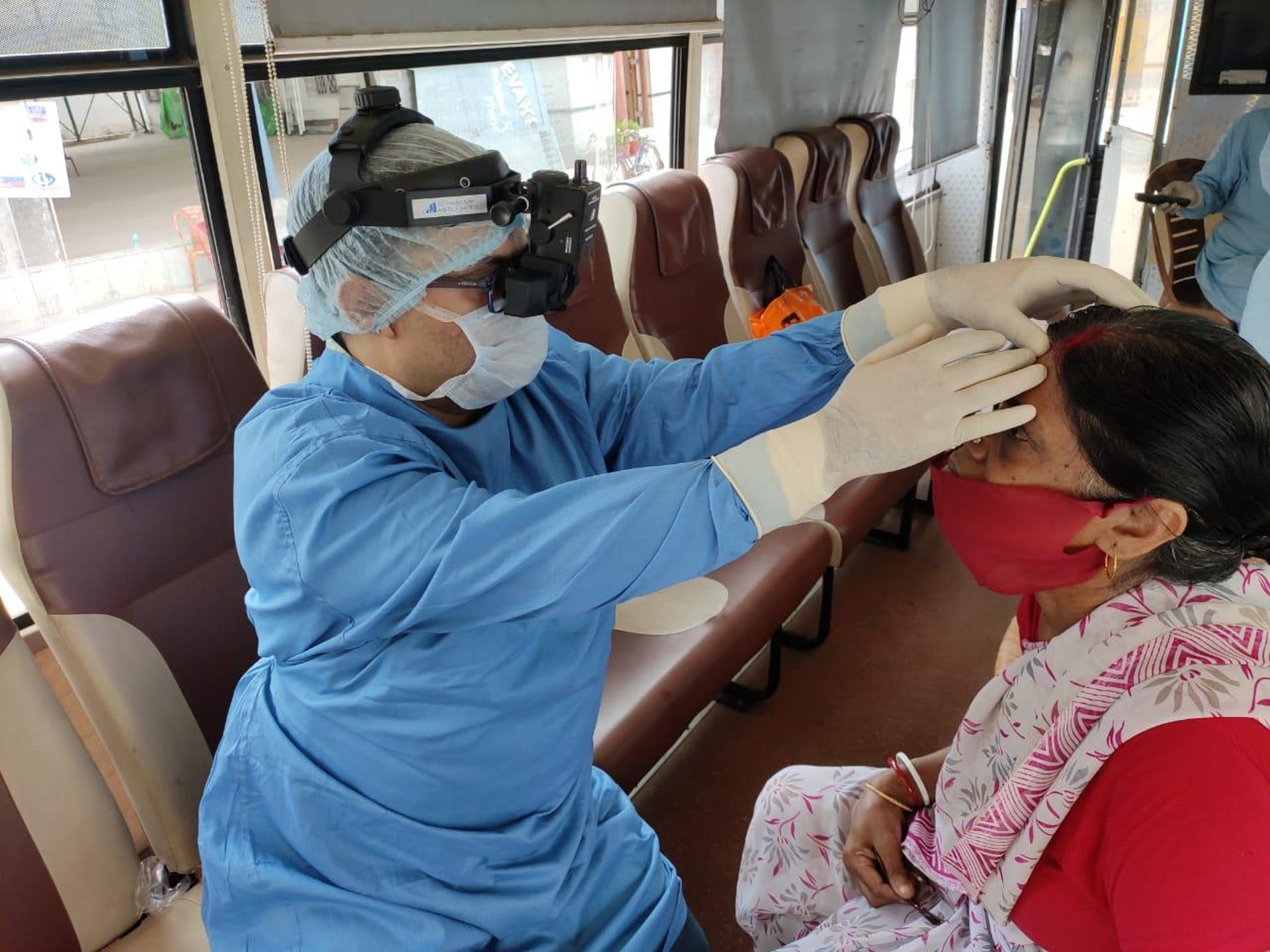 A woman is screened on board a vision van in Kolkata, India