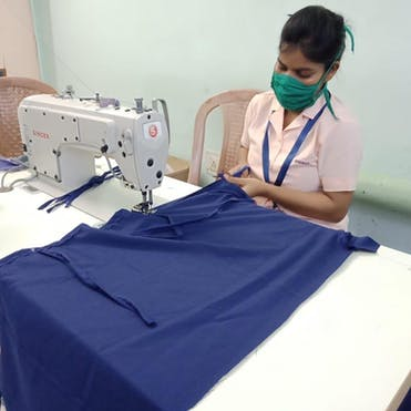A woman making PPE to protect eye health workers at Susrut Eye Foundation and Research Centre in Kolkata