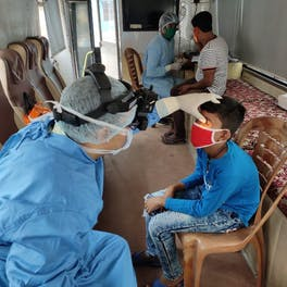 A young patient is screened on board a vision van run by the Susrut Eye Foundation and Research Centre in Kolkata
