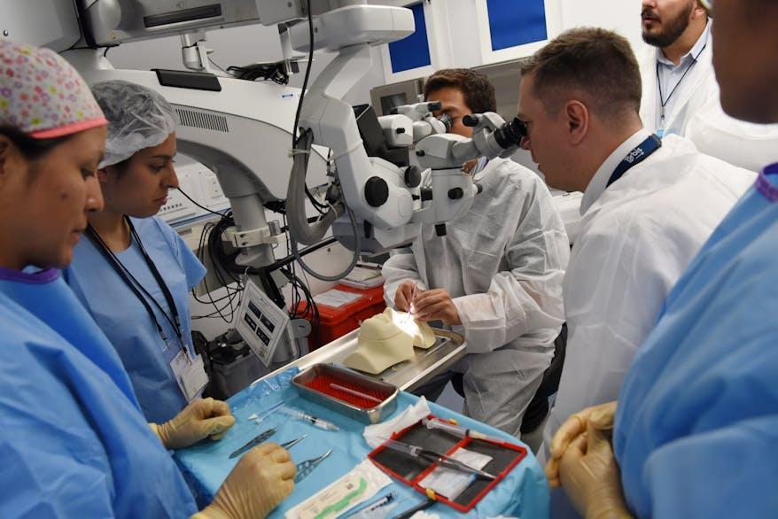 Trainee working on Eye training dummy.