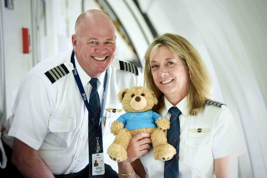 Cuddles with Orbis mascot Seymour the bear on the Orbis Flying Eye Hospital
