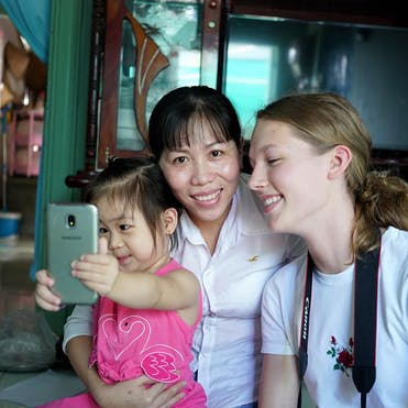 Truc takes selfies with her mom and Orbis volunteers