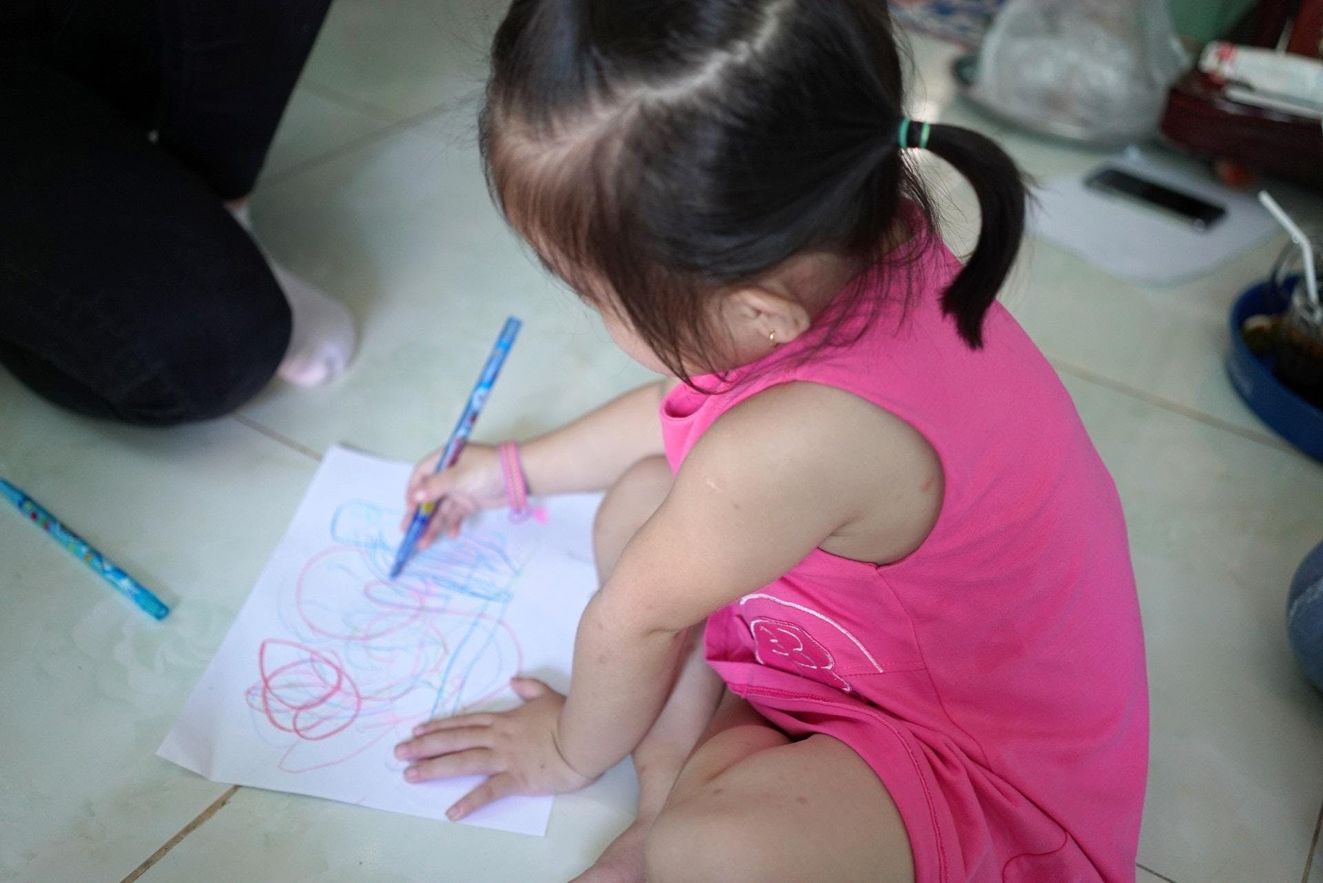Three-year-old Truc was treated for strabismus by Orbis trained eye doctors in Vietnam