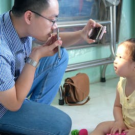 Three-year-old Truc is assessed for treatment by Orbis trained eye doctors in Vietnam