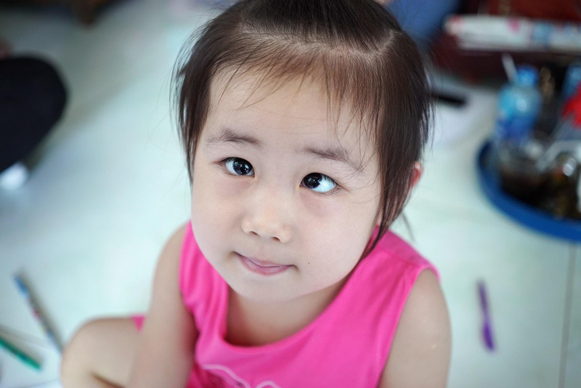 Three-year-old Truc had strabismus, but she had her vision saved thanks to Orbis trained eye surgeons