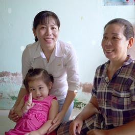 Truc is pictured here with her mother and grandmother at their home in Vietnam