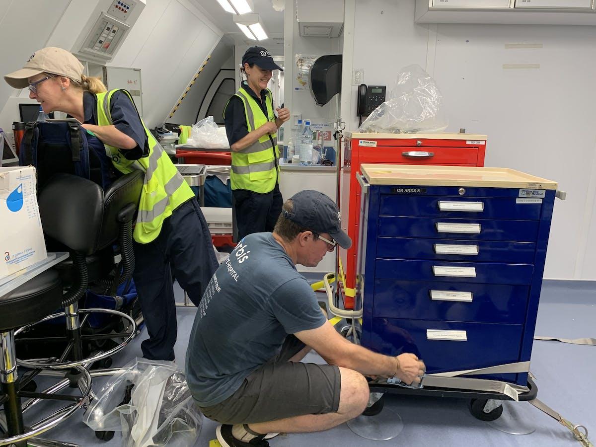 Members of the Orbis team pack up the Flying Eye Hospital after three weeks