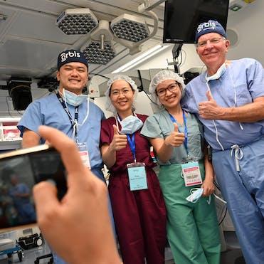 Dr Trúc on board the Flying Eye Hospital in Vietnam with Dr Lee Alward