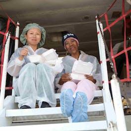Angela Purcell, FEH head nurse and Xiao Ying Liu, FEH staff nurse enjoy their lunch break in the belly of the Flying Eye Hospital in Trujillo in 2015