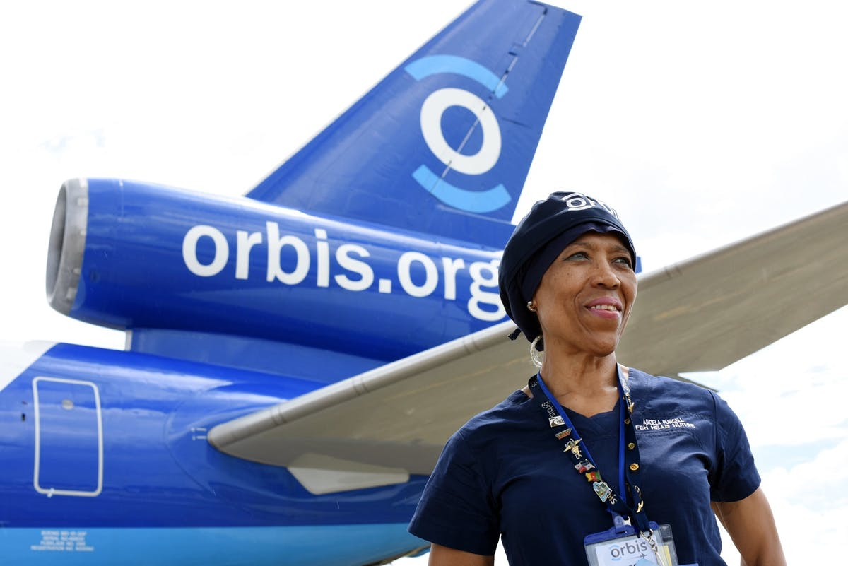 Angela Purcell pictured with the Orbis Flying Eye Hospital while on a mission
