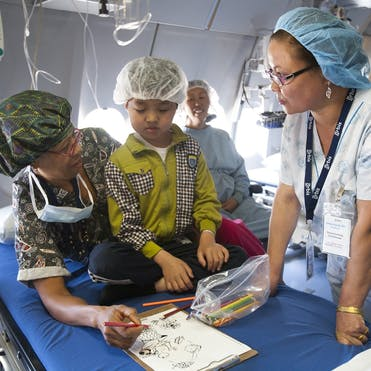 Angela Purcell treats a patient aboard the Flying Eye Hospital in Mongolia