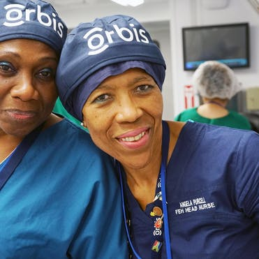 Angela Purcell picutred with a fellow nurse aboard the Flying Eye Hospital in Vietnam