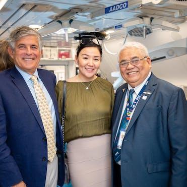 Bulgan is pictured with Dr. Jay Fleischman and Leo Mercado, staff nurse, on board the Flying Eye Hospital