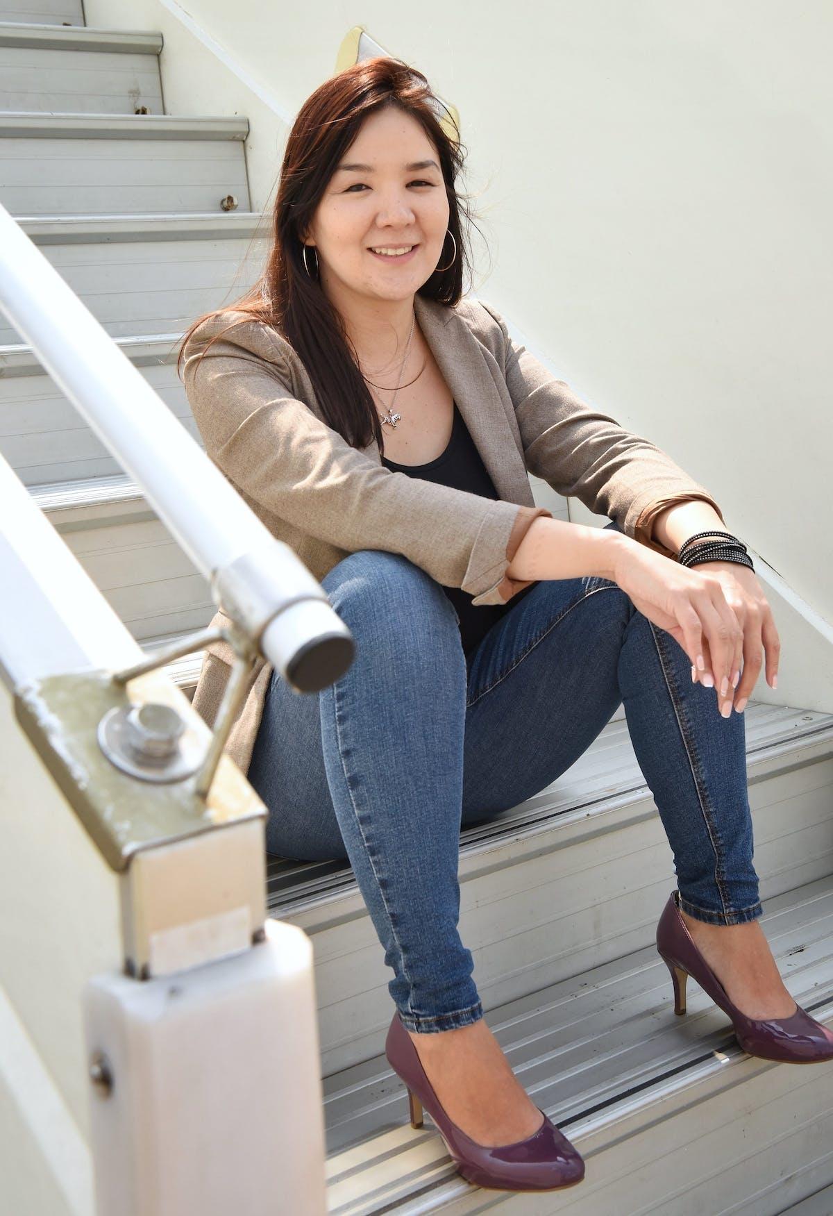 Bulgan sits on the steps of the Flying Eye Hospital in Mongolia