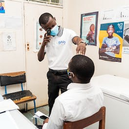 Charles Chikwanda screens a patient to check for eye conditions
