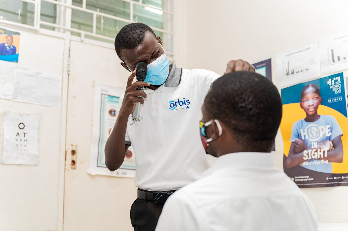 Charles screens a patient at the eye clinic