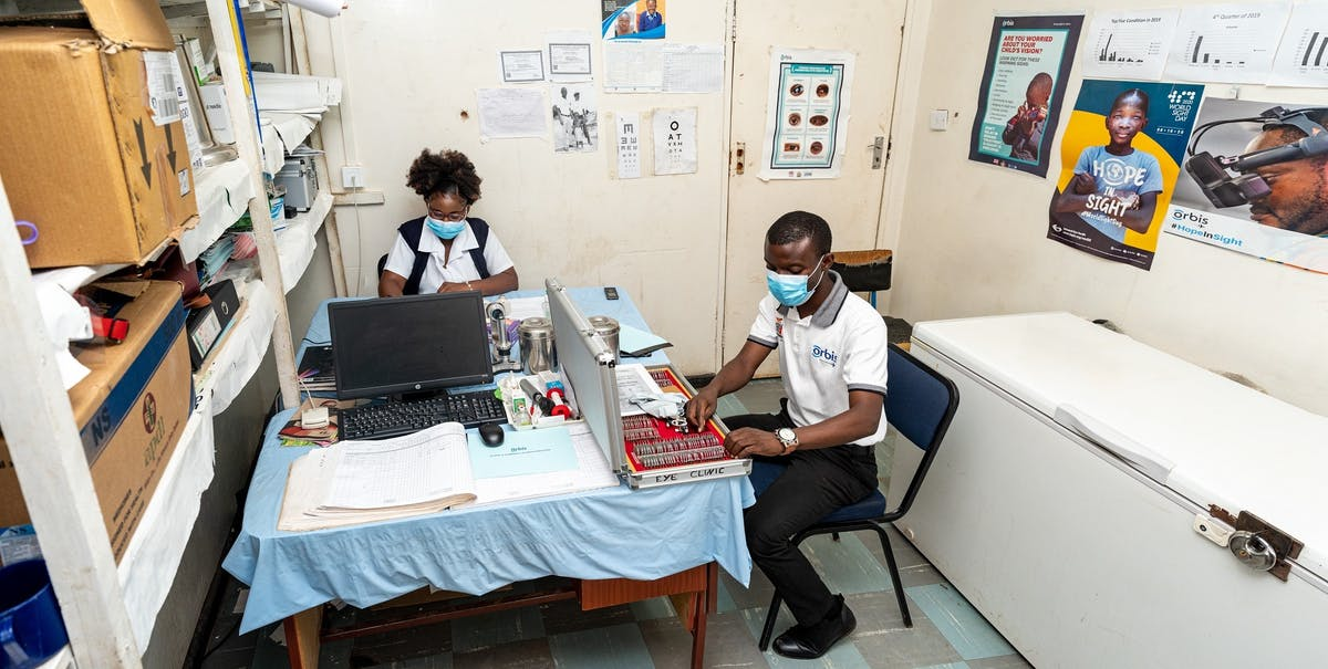 Charles shares an office with his colleague Regina at the eye clinic in Chililabombwe