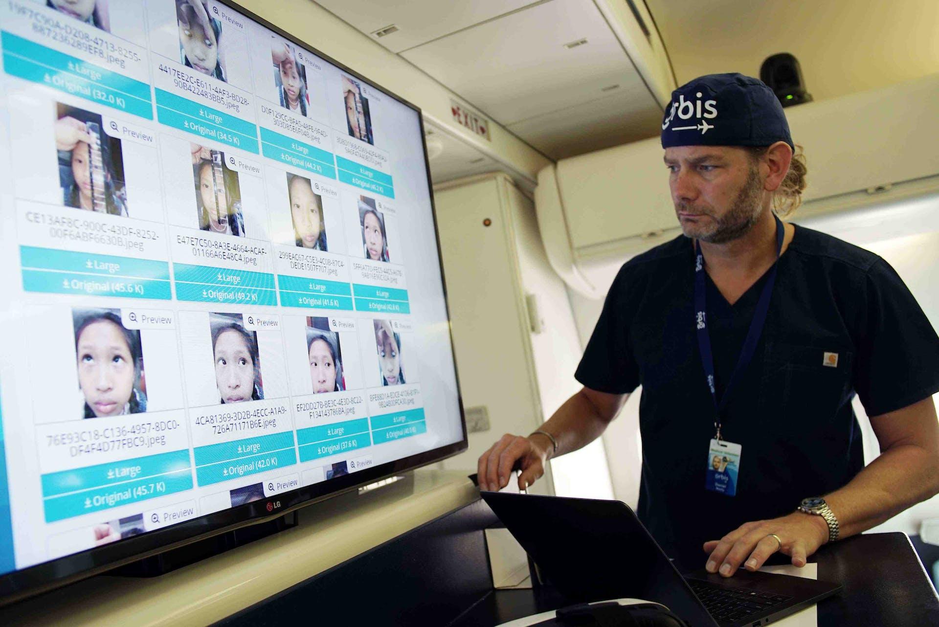 Dr. Daniel Neely using Cybersight to train local eye doctors during a Flying Eye Hospital program