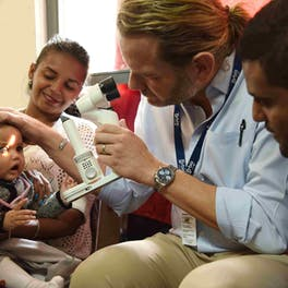 Dr. Daniel Neely screening a baby at a local partner hospital in Ethiopia
