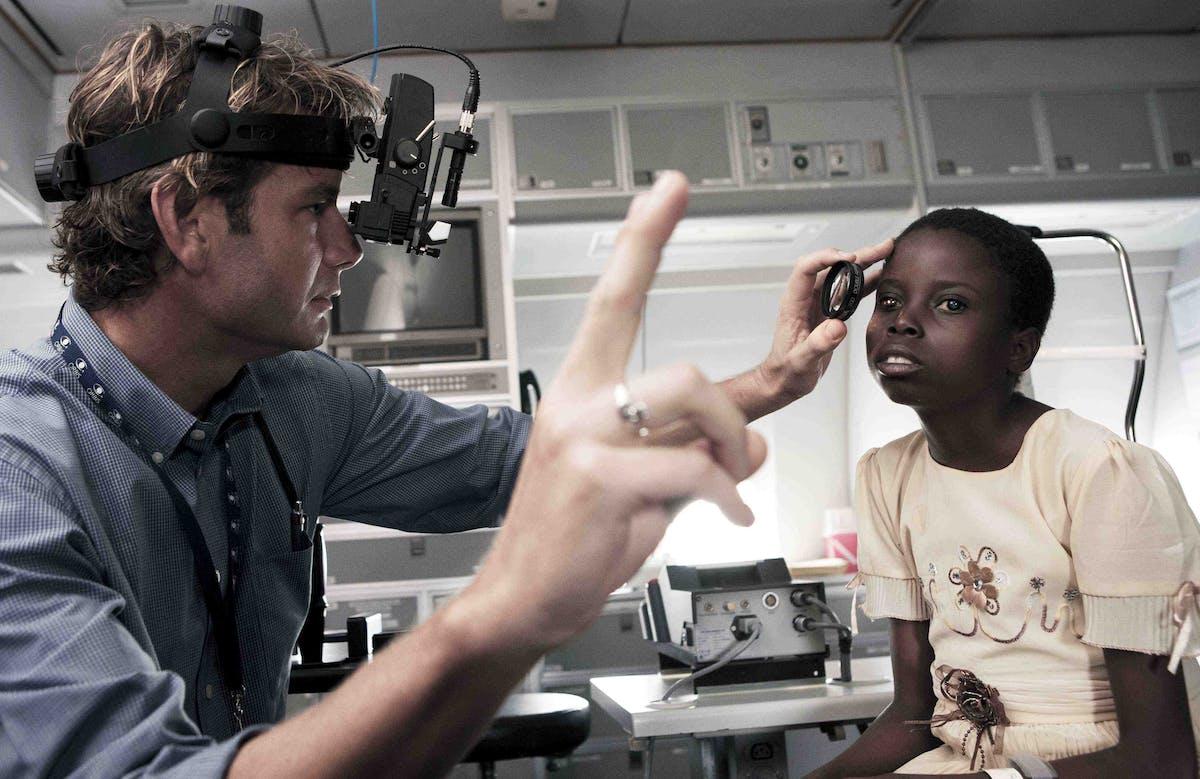 Volunteer Faculty Dr. Daniel Neely screening a child in Zambia