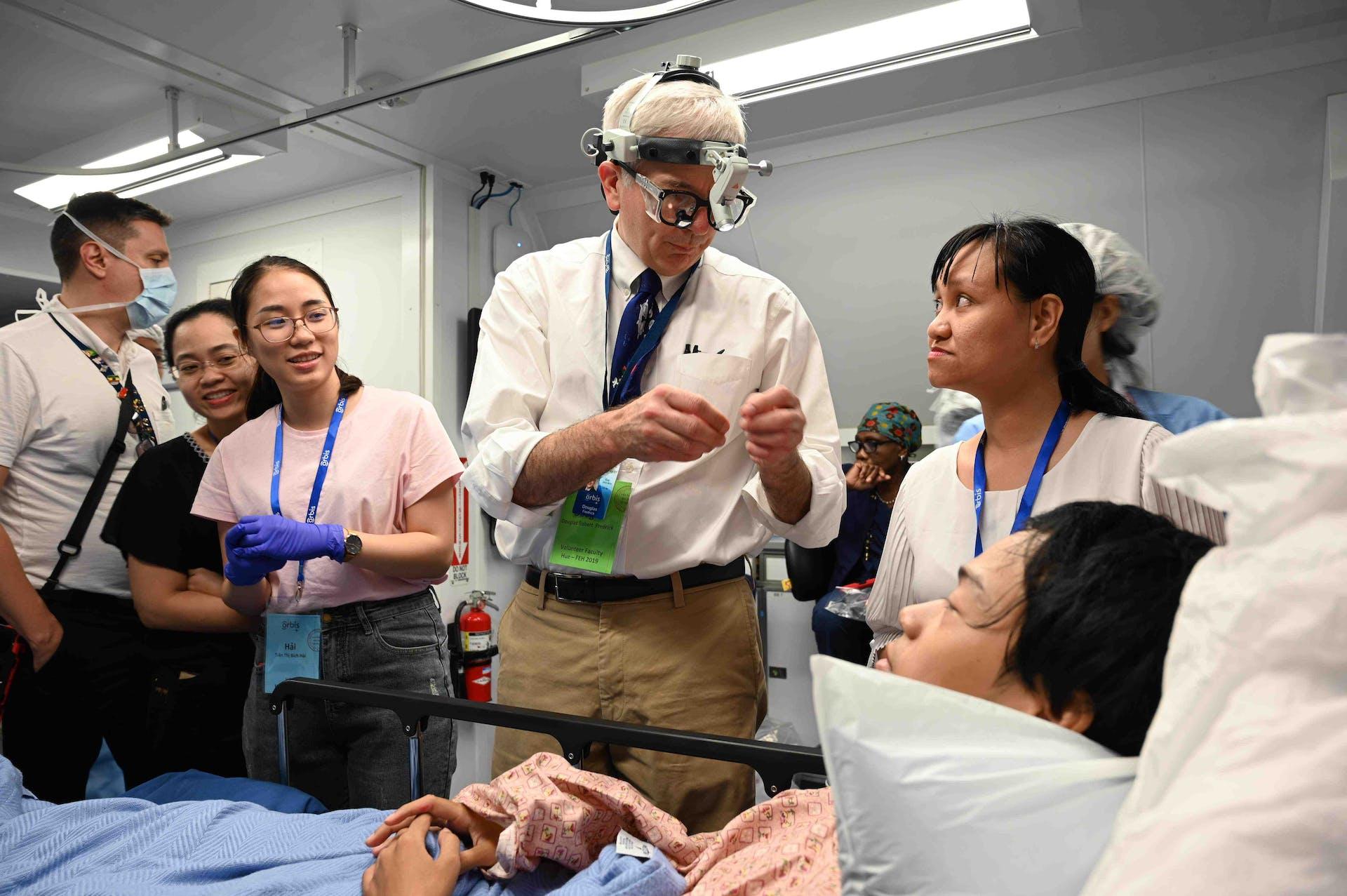 Dr. Douglas Fredrick training local eye doctors in Hue, Vietnam