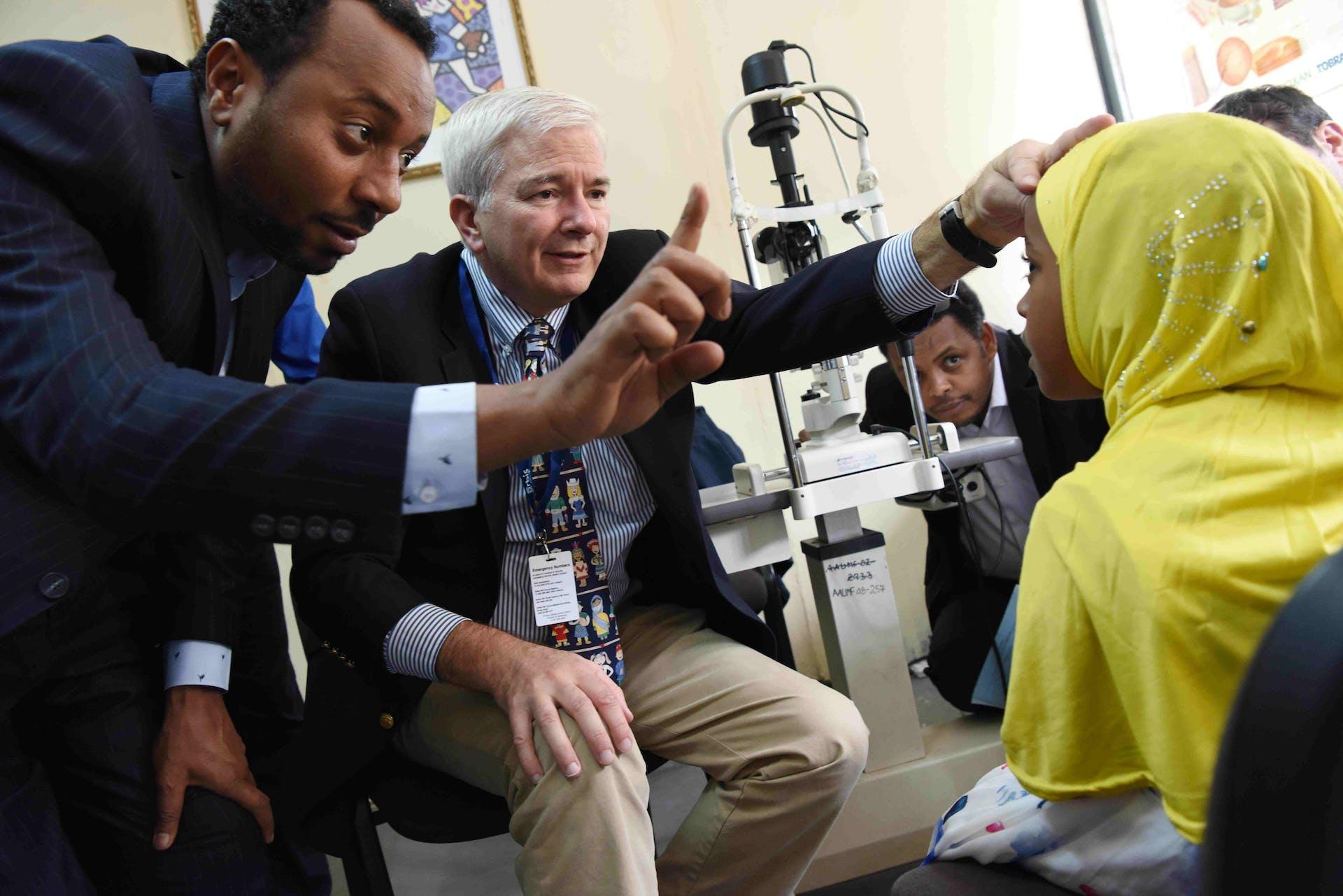 Dr. Douglas Fredrick pediatric strabismus specialist examining a patient at Menelik II Referral Hospital, Addis Ababa, Ethiopia
