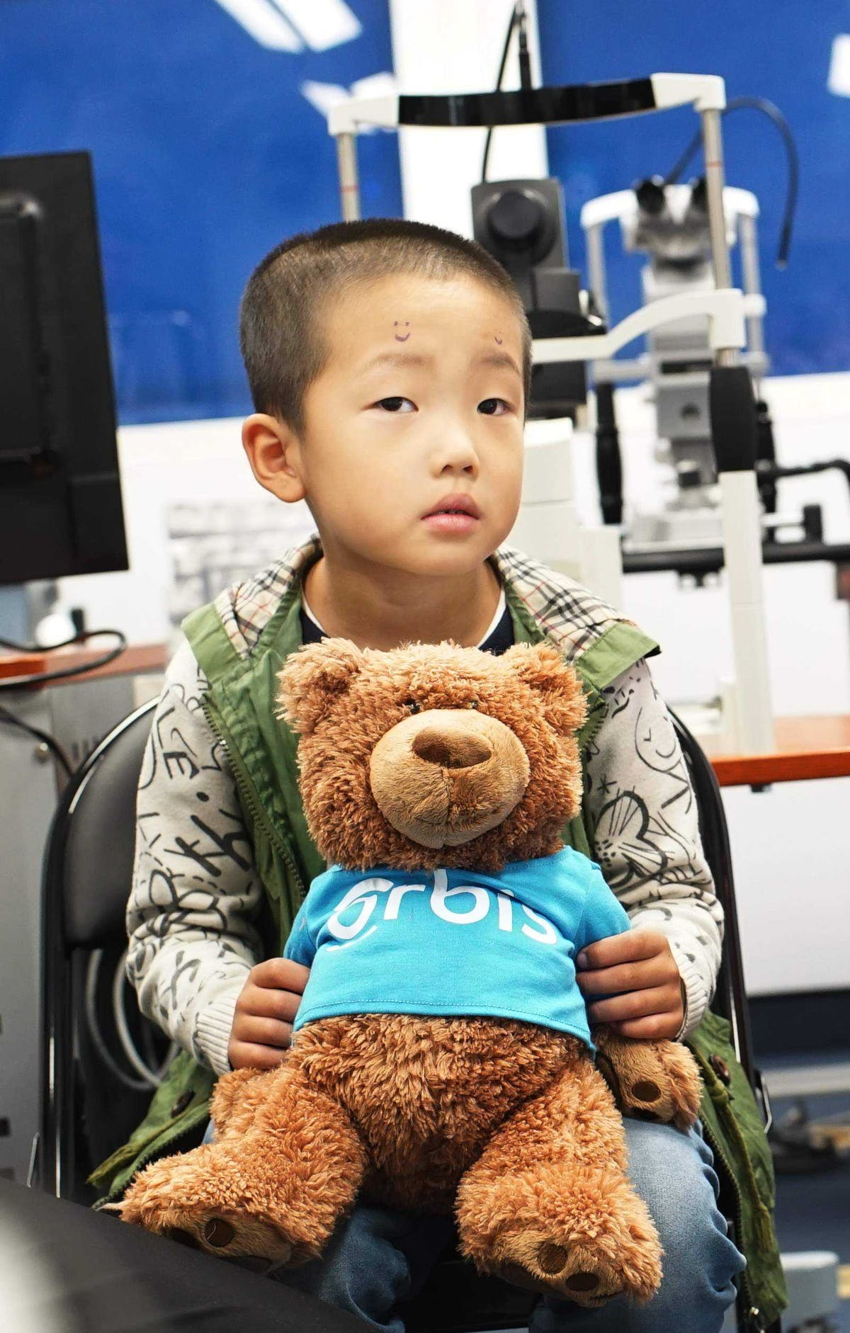 Zhang Yu's strabismus surgery was facilitated by Orbis volunteer Dr. Douglas Fredrick
