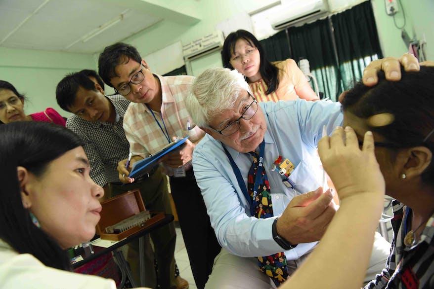 Orbis volunteer Dr. Monte Del with local eye physicians on screening day in Mandalay, Myanmar, 2019
