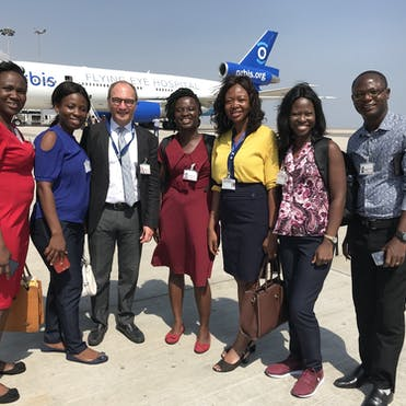 Dr. Peter Kertes pictured with local eye health teams during a Flying Eye Hospital program in Ghana