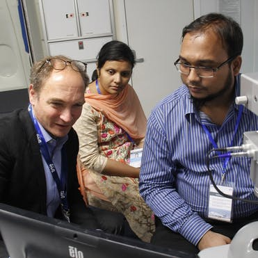 Dr. Peter Kertes trains local ophthalmogists on board the Flying Eye Hospital in Bangladesh
