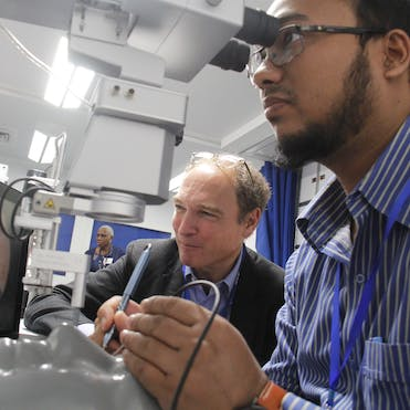 Dr. Peter Kertes teaches surgical techniques using simulation technology on board the Flying Eye Hospital in Bangaldesh back in 2017
