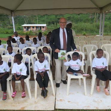 Ken Youngstein gives copies of The Singing Tree to school children in Cameroon