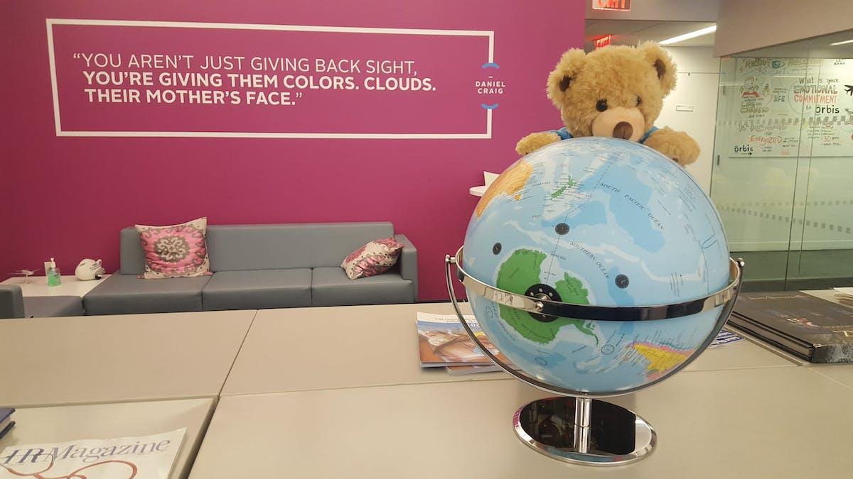Seymour studying the globe