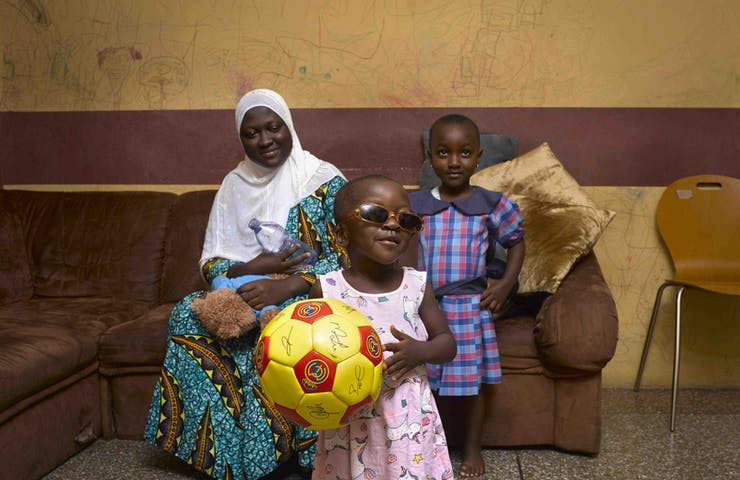 Hakeema with her mom and older sister post strabismus surgery in Ghana