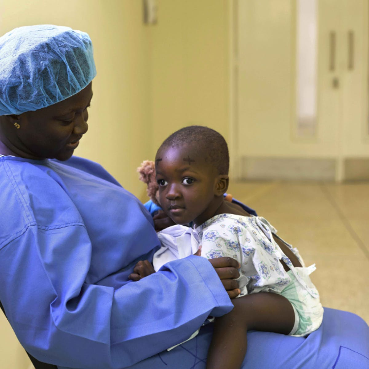 Brave Hakeema with her mom before her operation to correct her squint