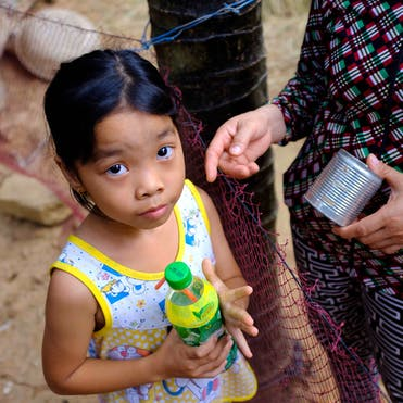8-year-old strabismus patient Phuong from Vietnam at home with her mother Lan