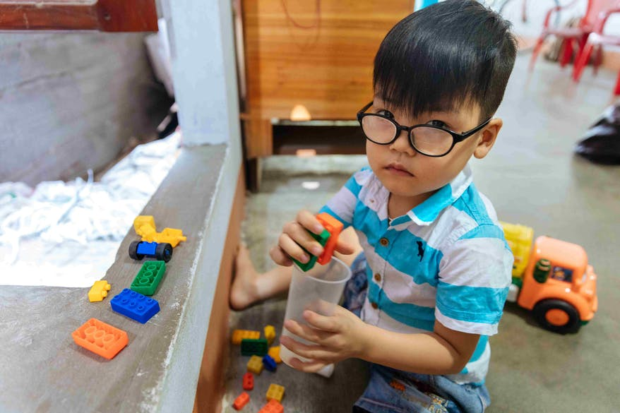 Vietnamese school boy Tam can playing with his favourite toys trains and cars after Orbis supporters kindly funded his bilateral cataracts surgery