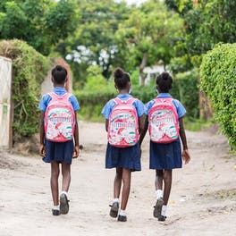 Shekaina Mildith and Stephanie walking to school in their home town Mufurila